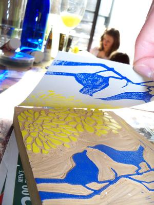 Peeling the invitation back from the stamp to reveal the work.